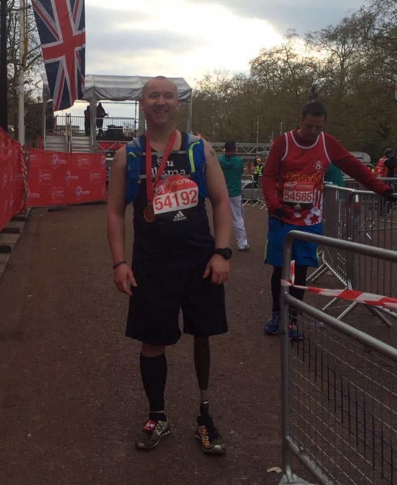 A man with a prosthetic leg, pictured after running a marathon.