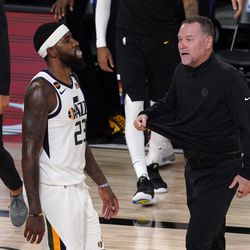 Utah Jazz's Royce O'Neale (23) walks past as Denver Nuggets head coach Michael Malone, right, walks onto the court during a time out in the second half an NBA first round playoff basketball game, Tuesday, Sept. 1, 2020, in Lake Buena Vista, Fla.