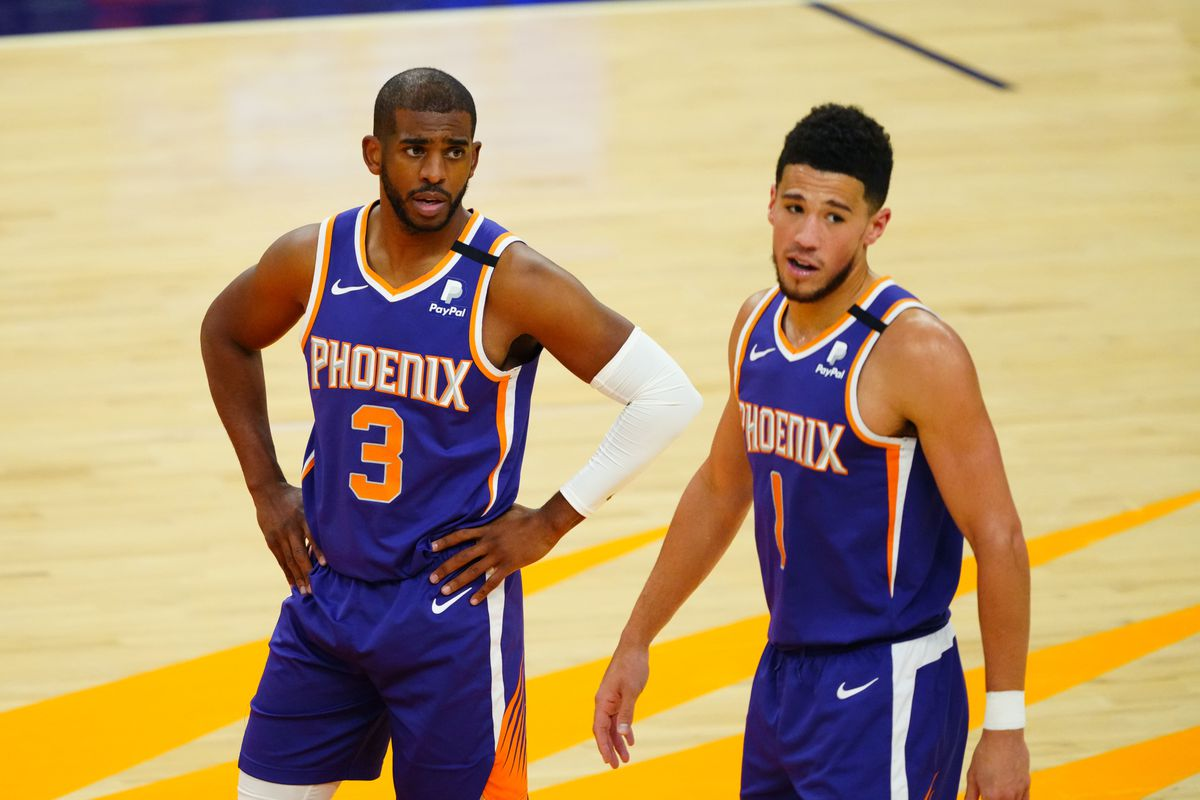 Phoenix Suns guard Chris Paul and Devin Booker against the Miami Heat in the second half at Phoenix Suns Arena.