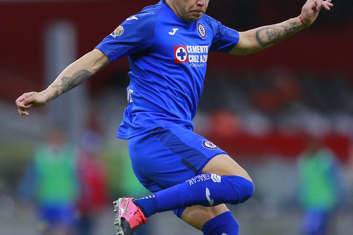 Jonathan Rodriguez of Cruz Azul drives the ball during the 10th round match between America and Cruz Azul as part of the Torneo Clausura 2020 Liga MX at Azteca Stadium on March 15, 2020 in Mexico City, Mexico.