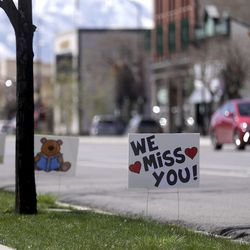 """Signs posted outside of the Springville Library in Springvillesay """"We Miss You"""" and """"Stay Well"""" on Wednesday, April 8, 2020."""