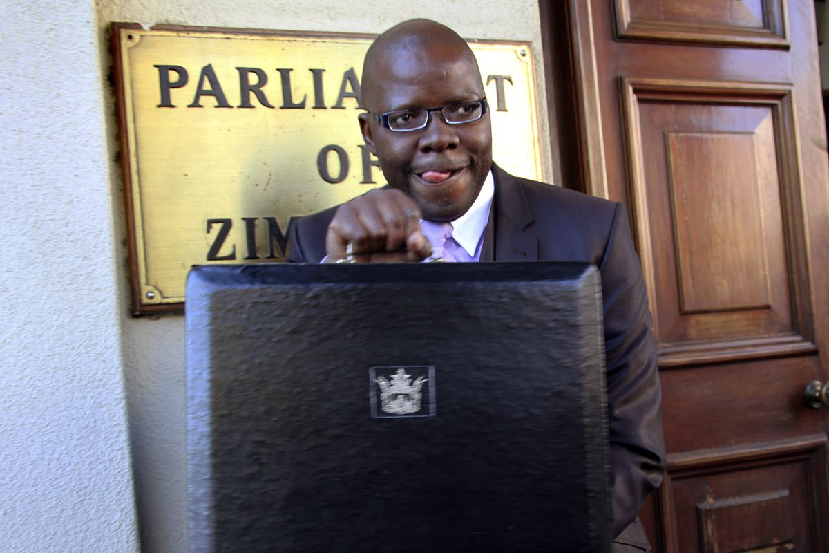 FILE - In this July, 18, 2012 file photo Tendai Biti, stands outside the Parliament Building in Harare, Zimbabwe. A Zimbabwean lawyer says that senior opposition official Tendai Biti has been arrested. Nqobizitha Mlilo, the lawyer, said Biti was arrested