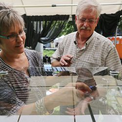 Sandy and Shannon Murphy of Murphy Originals in Colorado Springs assemble display cases as they and other artists get set up for the Utah Arts Festival in Salt Lake City on Wednesday, June 21, 2017.