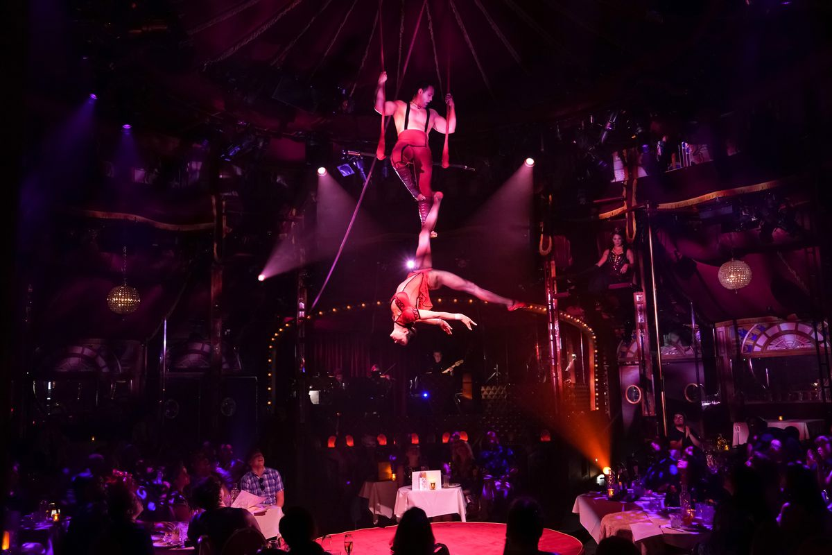 """Duo Rose performs their aerial acrobatics inside the Spiegeltent ZaZou at Teatro ZinZanni's production of """"Love, Chaos & Dinner"""" in Chicago."""