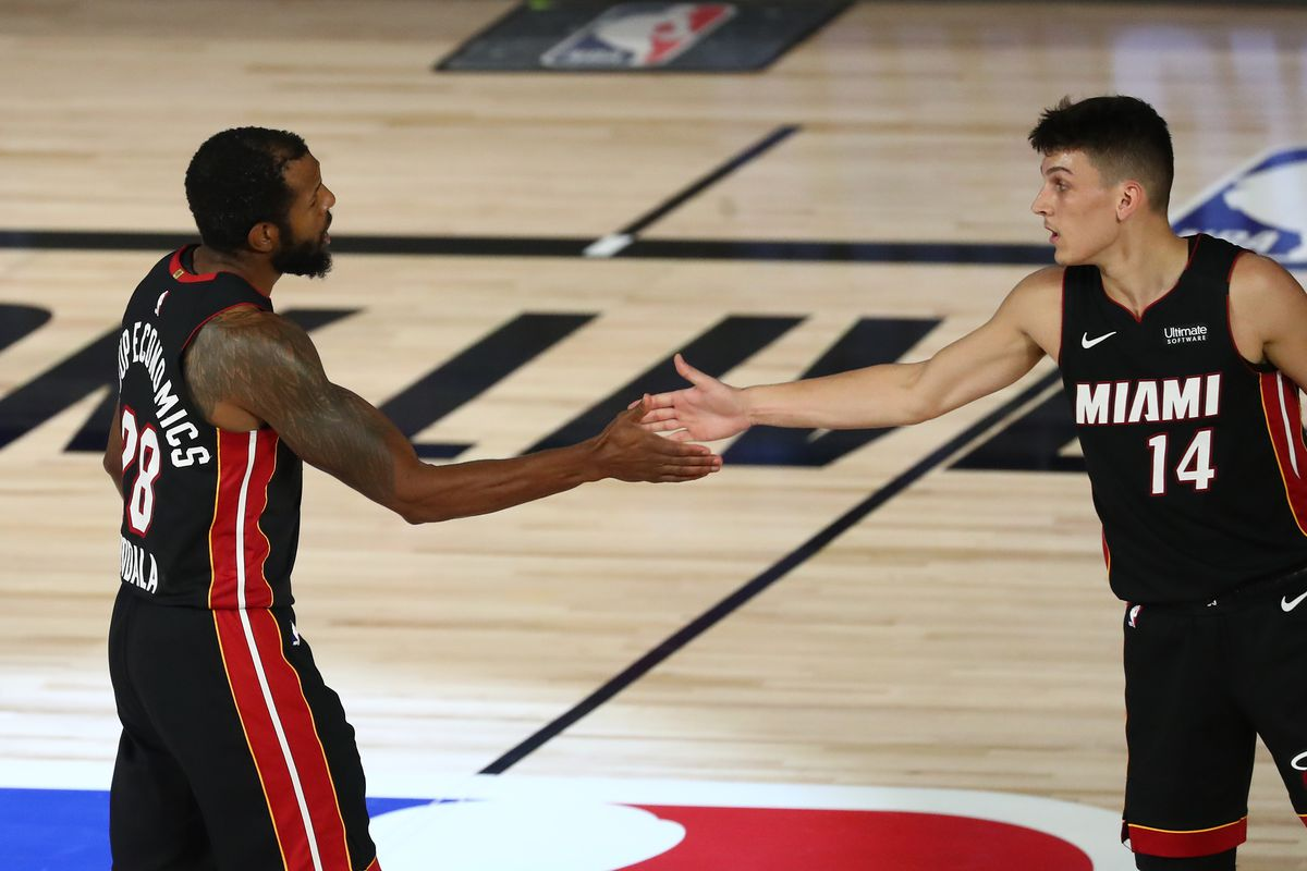Miami Heat guard Andre Iguodala celebrates with guard Tyler Herro after dunking against the Milwaukee Bucks during the second half of game five in the second round of the 2020 NBA Playoffs at ESPN Wide World of Sports Complex.