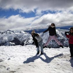Tourists play on a mountain in San Carlos de Bariloche, Argentina, Friday, Sept. 21, 2012. Thousands of Argentines began enjoying Friday  to make the most of the long weekend, which lawmakers approved just three weeks ago. Monday's Sept. 24th holiday makes for a total of 19 national paid holidays this year. Only Colombia comes close in Latin America, with 18.