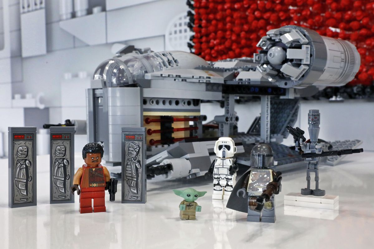 The LEGO 1,023 piece The Razor Crest, and collectible figures, are displayed at Toy Fair New York in February.