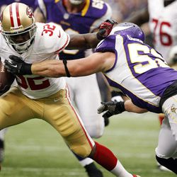 San Francisco 49ers running back Kendall Hunter (32) tries to break a tackle by Minnesota Vikings outside linebacker Chad Greenway, right, during the first half of an NFL football game, Sunday, Sept. 23, 2012, in Minneapolis.