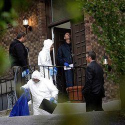 Crime Scene Investigators search the Warhola home in Layton on September 9, 2010.