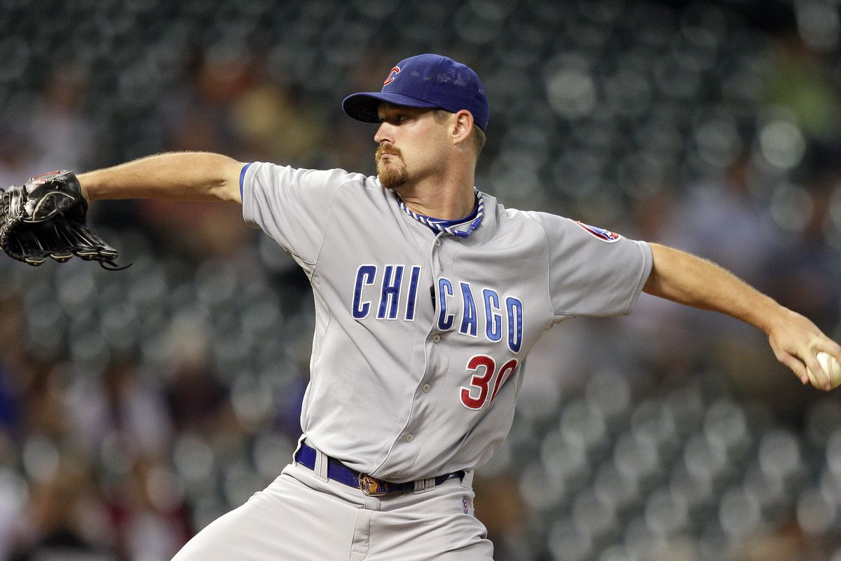 Travis Wood of the Chicago Cubs pitches against the Houston Astros at Minute Maid Park in Houston, Texas. (Photo by Bob Levey/Getty Images)