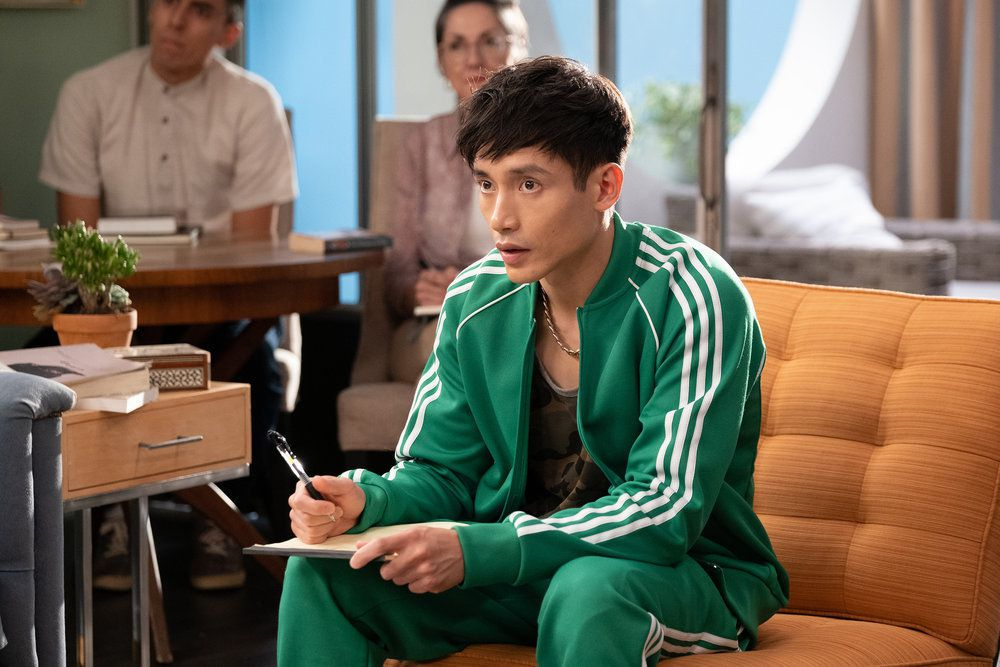 """Jason (Manny Jacinto) takes notes in a screenshot from The Good Place season 4, episode 13, """"Whenever You're Ready"""""""