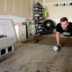 Kyle Collinsworth does pushups as he and his wife, Shea Collinsworth, do a short workout at their Provo home on Wednesday, April 22, 2020.