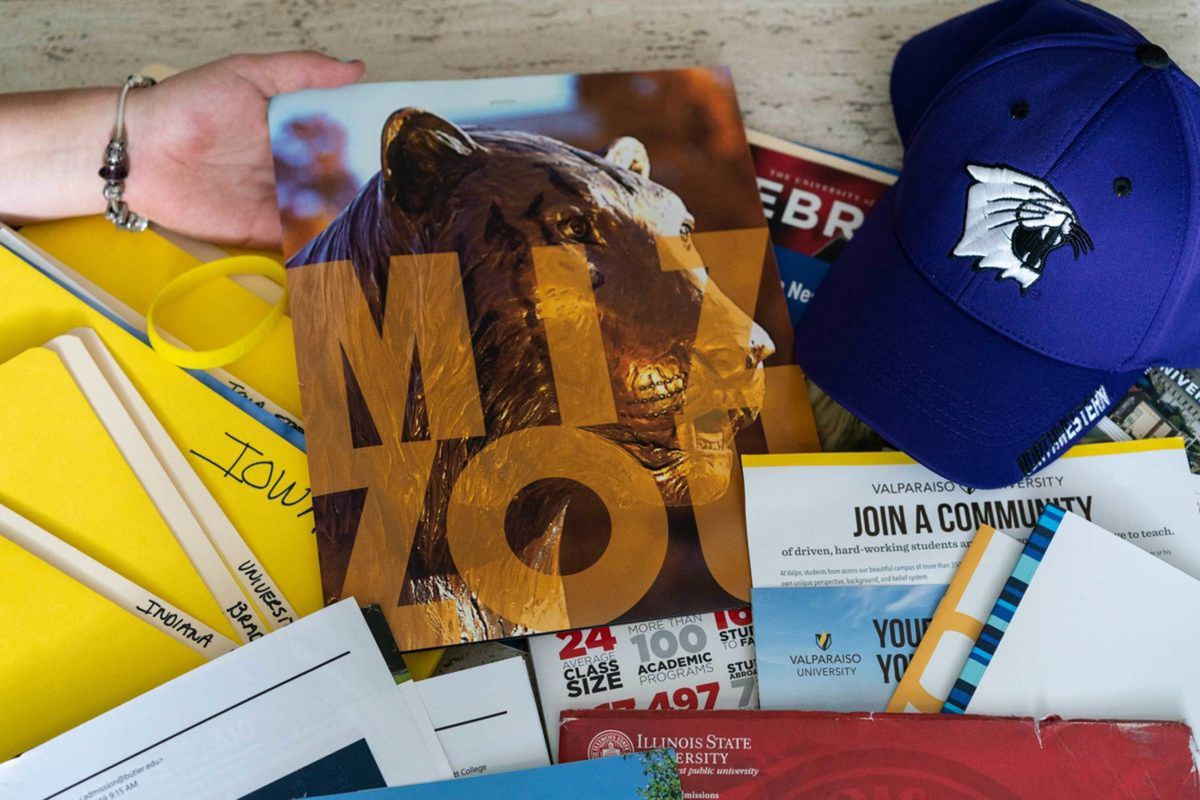 A Northbrook mother who dropped the idea of giving up guardianship of her daughter displays some of the college brochures she has received.