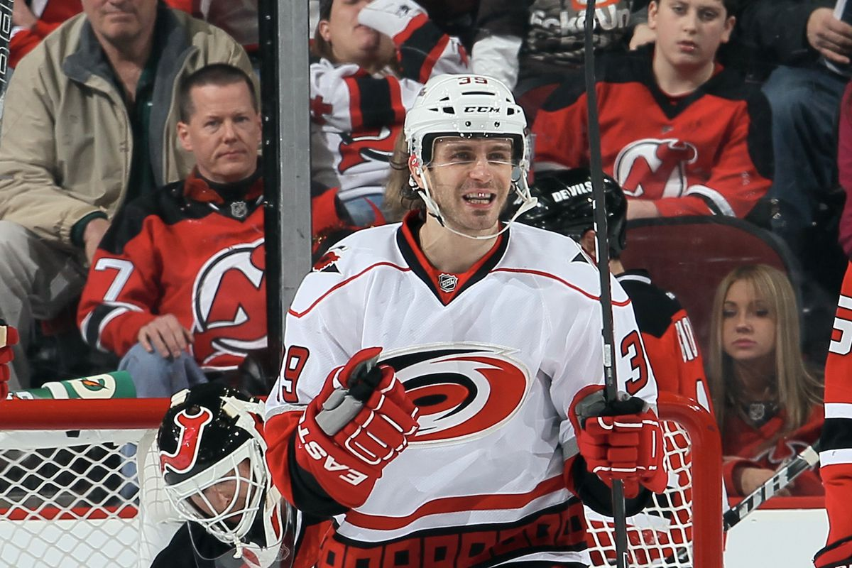 Patrick Dwyer deflected a shot past Martin Brodeur and is pleased.  Brodeur and the fans behind the glass are understandably not pleased.