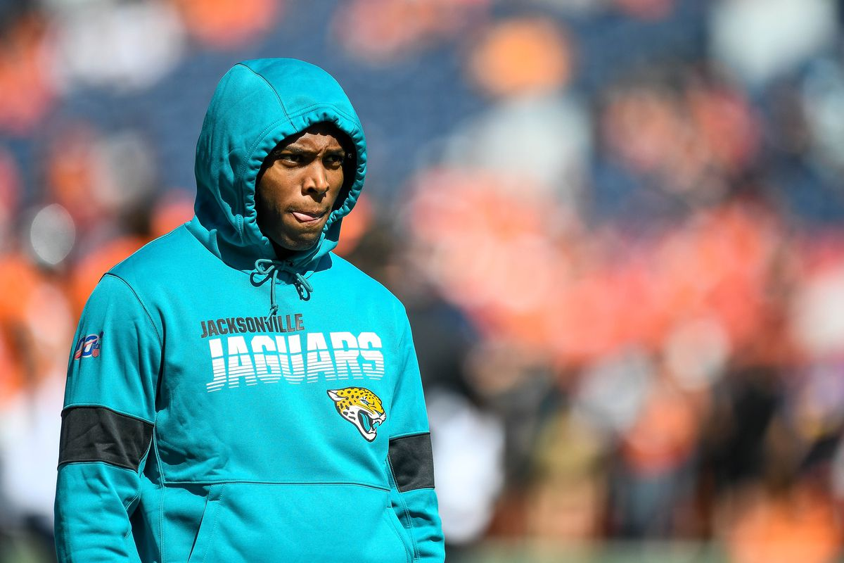 Jalen Ramsey of the Jacksonville Jaguars stands on the field in street clothes as players warm up before a game against the Denver Broncos at Empower Field at Mile High on September 29, 2019 in Denver, Colorado.