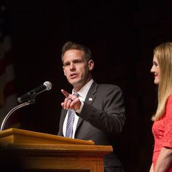 Damian Kidd and his wife, Jenifer, stand on the stage during Kidd's speech while campaigning for the vote of Republican delegates during the GOP convention at Timpview High School in Provo on Saturday, June 17, 2017.