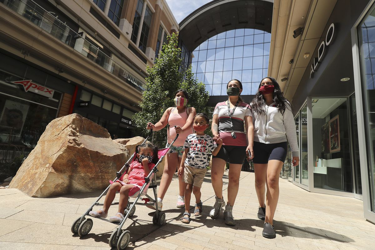 Ana Rodriguez shops with her children, Aneisa, Giovanni, Rihanna and America, at City Creek Center in Salt Lake City on Wednesday, May 6, 2020. The shopping center reopened Wednesday.