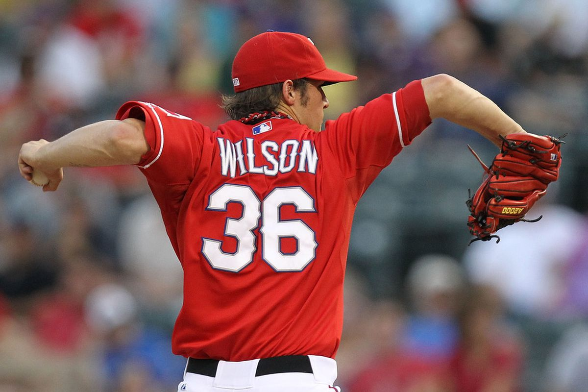 ARLINGTON, TX - SEPTEMBER 01:  C.J. Wilson #36 of the Texas Rangers throws against the Tampa Bay Rays at Rangers Ballpark in Arlington on September 1, 2011 in Arlington, Texas.  (Photo by Ronald Martinez/Getty Images)