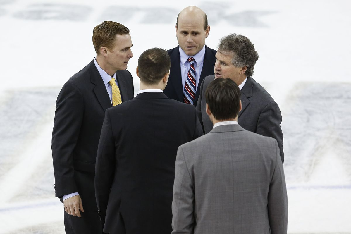 Mike Schafer and Rand Pecknold exchange pleasantries prior to the Cornell coach going off in the post game press conference.