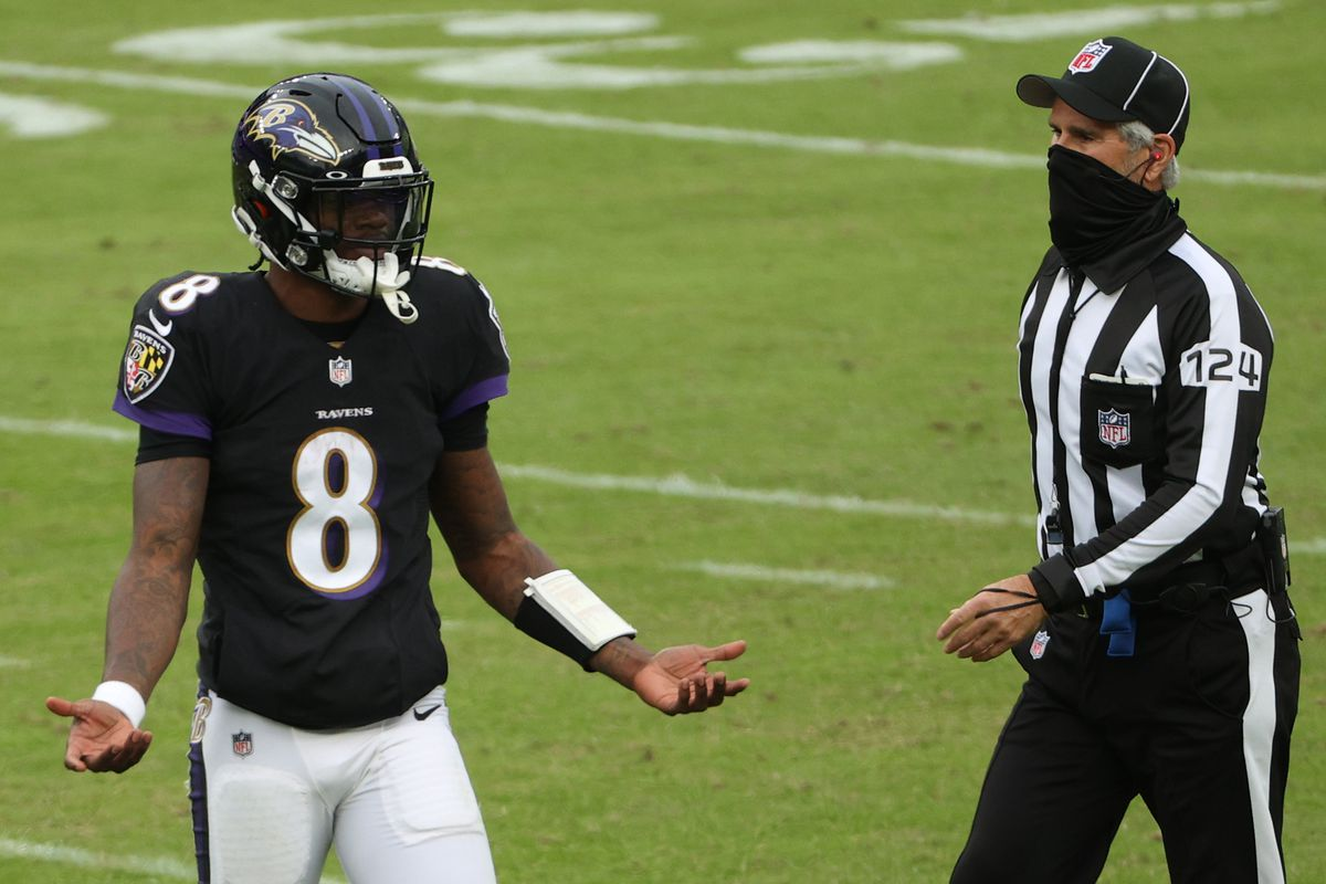 Quarterback Lamar Jackson of the Baltimore Ravens reacts after throwing an interception against the Tennessee Titans during the second half at M&T Bank Stadium on November 22, 2020 in Baltimore, Maryland.
