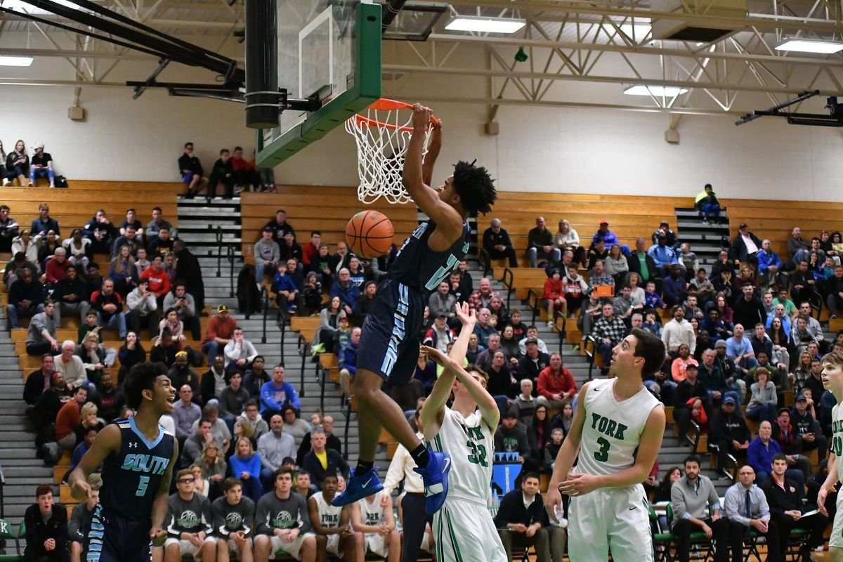 Downers Grove South's Wesley Hooker (22) gets a dunk against York in the title gave of the Jack Tosh Holiday Tournament.