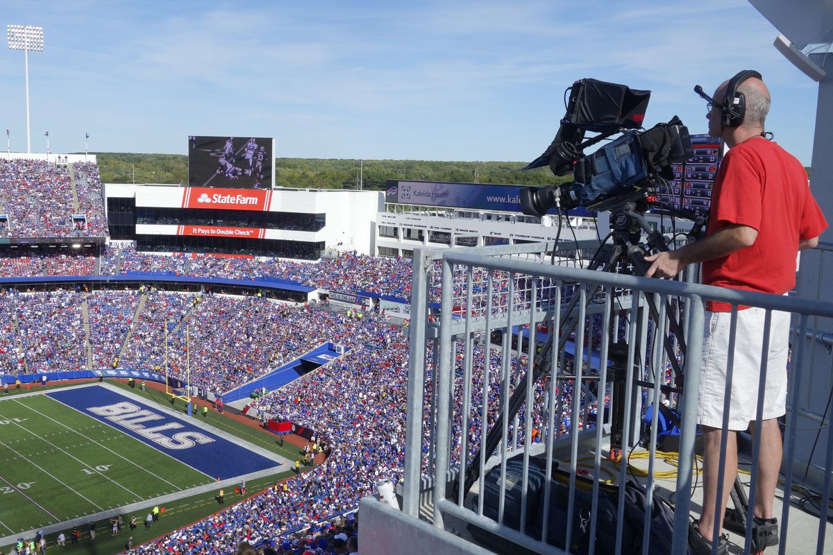 Cameraman at NFL Football Game, Orchard Park, New York, United States