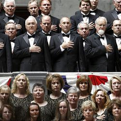 Members of the American Festival Choir stand with hands over their hearts during the national anthem at the swearing-in ceremony for Utah's new Gov. Gary Herbert.
