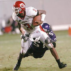 Utah quarterback Brian Johnson can't break the tackle of TCU's Robert Henson during the Utes' first loss in 19 games.