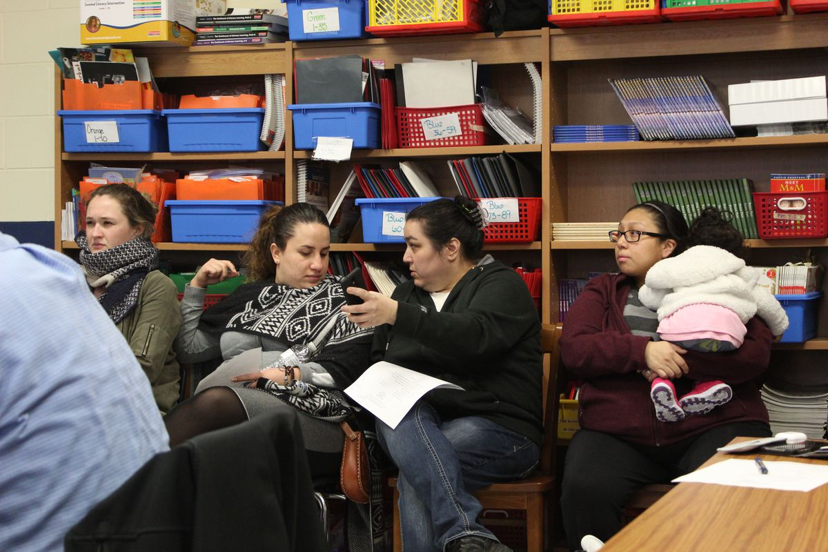 Michelle Villa listens as school officials explain their plans to turn things around at the Southwest Detroit Community School.