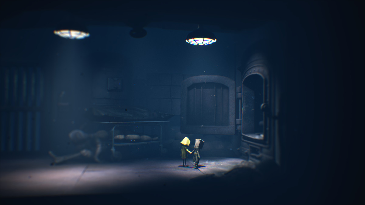 Six and Mono hold hands outside of an incinerator in Little Nightmares 2