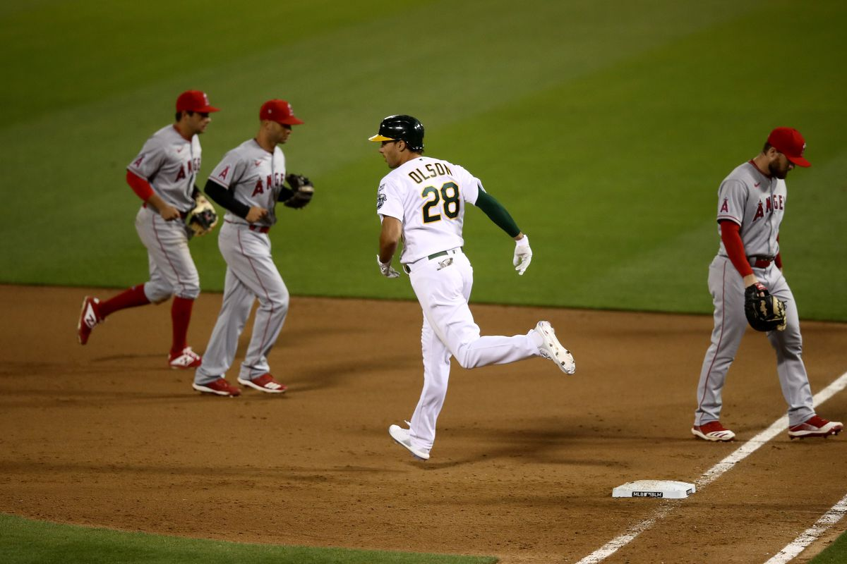Matt Olson of the Oakland Athletics rounds the bases after he hit a grand slam home run in the tenth inning to beat the Los Angeles Angelsduring opening day at Oakland-Alameda County Coliseum on July 24, 2020 in Oakland, California.