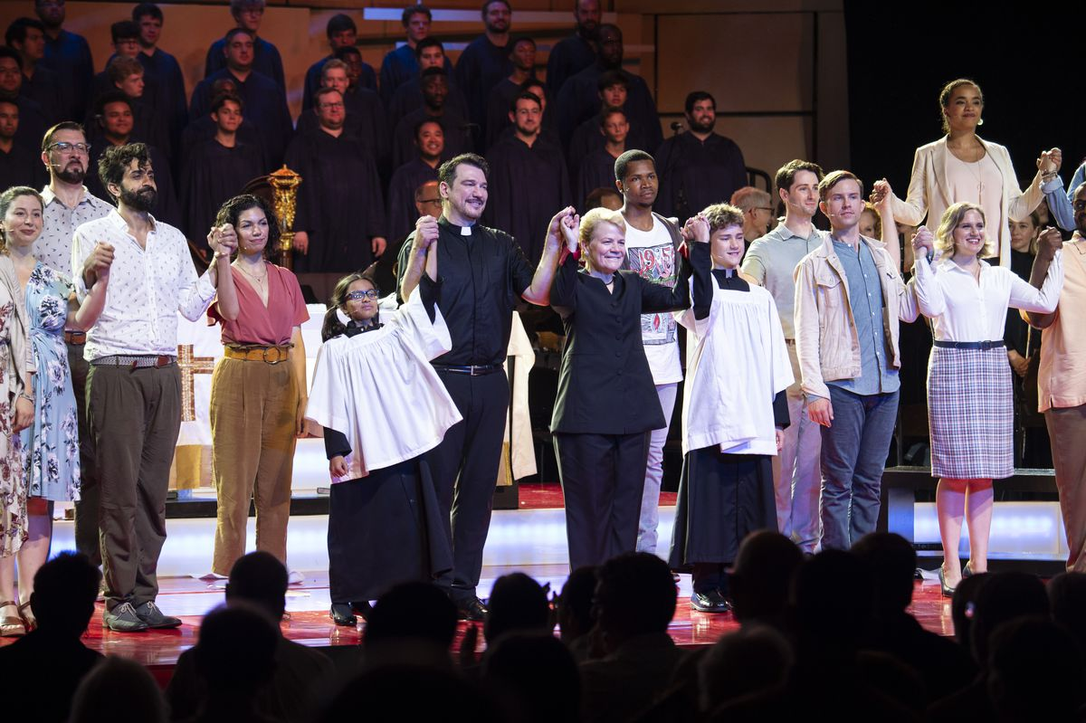 Conductor Marin Alsop (center) leads the curtain call following a performance of Bernstein's Mass at Ravinia in 2018.