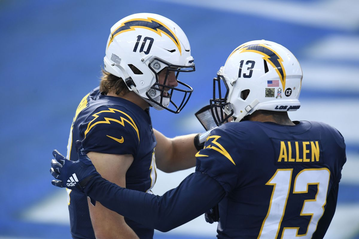 Keenan Allen #13 of the Los Angeles Chargers celebrates his second quarter touchdown with Justin Herbert #10 while playing the Las Vegas Raiders at SoFi Stadium on November 08, 2020 in Inglewood, California.