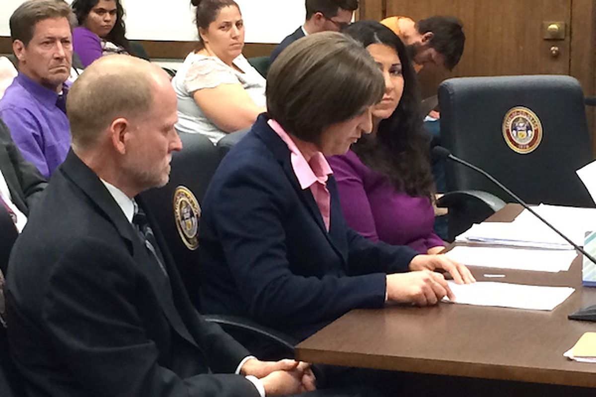 Desiree Davis (center) testifies at the Capitol while husband Michael (left) listens.