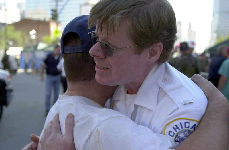 Jim Maloney (right) hugs his brother Pat Maloney on Sept. 15, 2001, after they found each other near the site of the World Trade Center's collapse. Jim Maloney was a Chicago police officer. Pat Maloney was a Chicago firefighter.