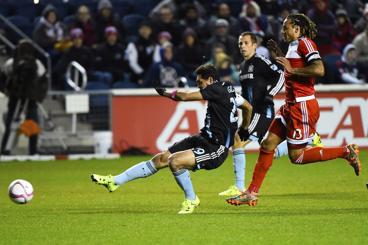 Gilberto takes his shot, marked closely by Jermaine Jones