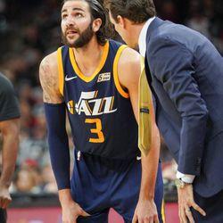 Utah Jazz head coach Quin Snyder, right, talks to Jazz guard Ricky Rubio during the second half of an NBA basketball game against the San Antonio Spurs, Saturday, Feb. 3, 2018, in San Antonio. Utah won 120-111. (AP Photo/Darren Abate)