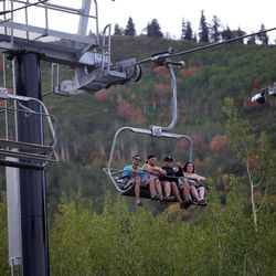 People take a scenic chairlift ride at Park City Mountain Resort in Park City on Friday, Sept. 5, 2014.