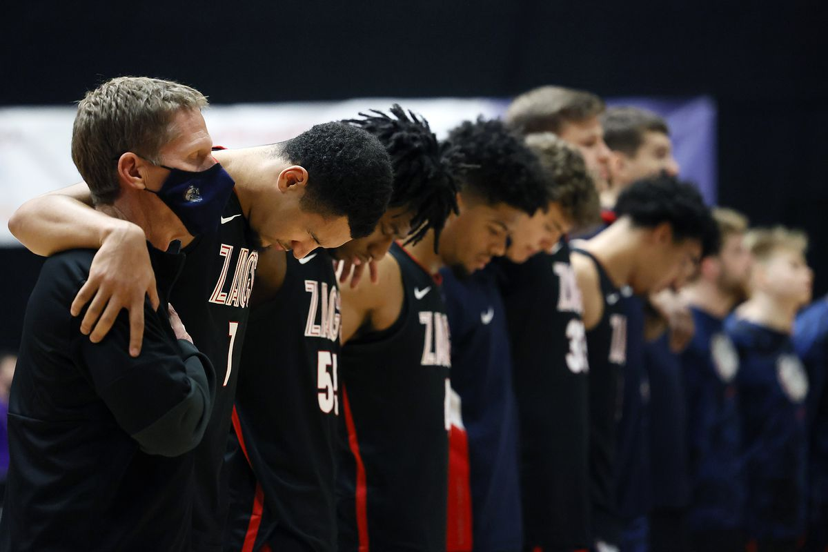 Head coach Mark Few of the Gonzaga Bulldogs stands with his players during the playing of the national anthem prior to the game against the Portland Pilots at Chiles Center on January 09, 2021 in Portland, Oregon.