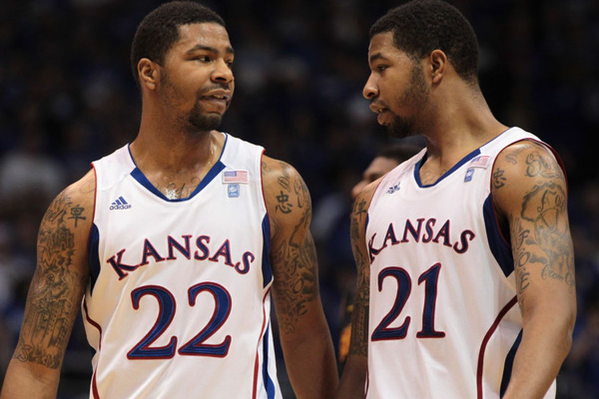 LAWRENCE KS - DECEMBER 18:  Marcus Morris #22 and Markieff Morris #21 of the Kansas Jayhawks talk during the game against the USC Trojans on December 18 2010 at Allen Fieldhouse in Lawrence Kansas.  (Photo by Jamie Squire/Getty Images)