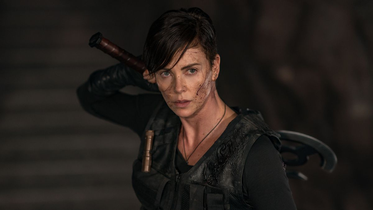 Charlize Theron prepares to draw her axe in The Old guard