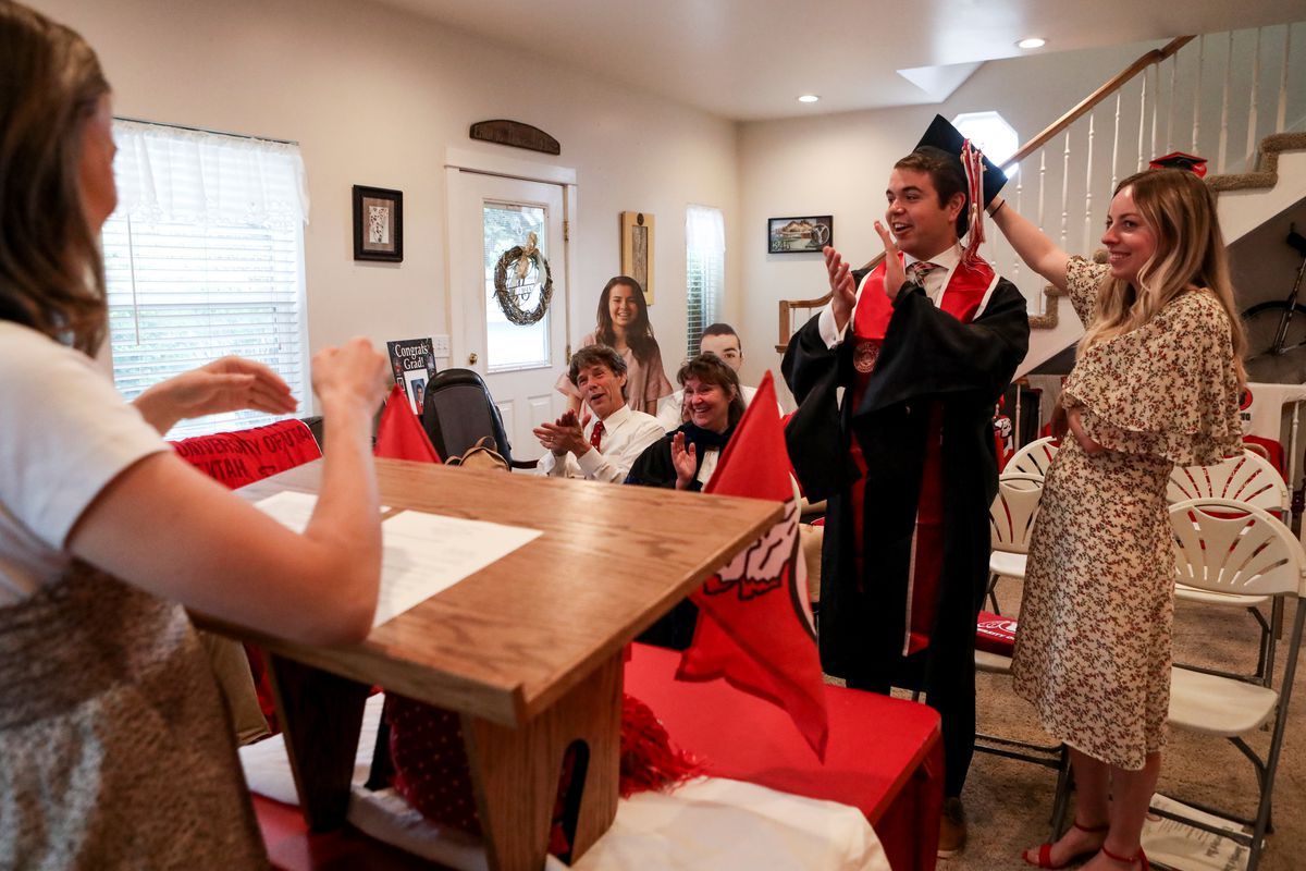 The Hallman family hosts a mock commencement ceremony for their University of Utah graduate in their Sugar House home amid the COVID-19 pandemic on Thursday, April 30, 2020. Joseph Hallman earned bachelor's degrees in Latin American studies, Spanish and international business with an emphasis in trade commerce in 2019 with hopes of walking during the spring 2020 commencement ceremony.