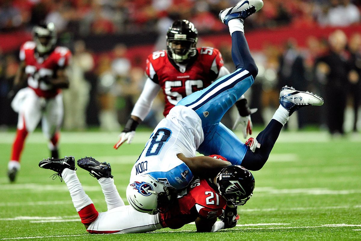 ATLANTA, GA - NOVEMBER 20:  Chris Owens #21 of the Atlanta Falcons upends Jared Cook #89 of the Tennessee Titans during play at the Georgia Dome on November 20, 2011 in Atlanta, Georgia. The Falcons won 23-17.  (Photo by Grant Halverson/Getty Images)