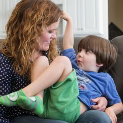 Heidi Wallis talks with her youngest son, Louie, who shares a rare disease — guanidinoacetate methyltransferase (GAMT) deficiency — with his sister, Sam, during an interview at their home in Bluffdale on Wednesday, Nov. 2, 2016. Heidi Wallis and her husband, Trey, are fighting to have GAMT screening placed on the national newborn screening list.