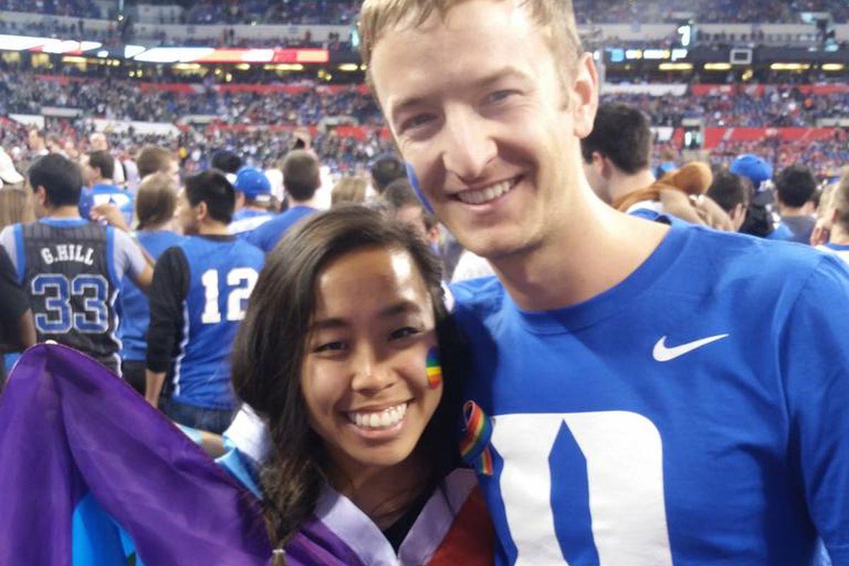 Duke undergrad Emily Kuo and Duke MBA student Cameron Platt wearing and sharing rainbows at Lucas Oil Stadium.