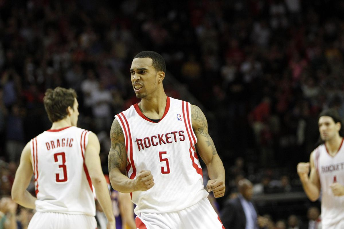 Mar 20, 2012; Houston, TX, USA; Houston Rockets guard Courtney Lee (5) reacts against the Los Angeles Lakers in the fourth quarter at the Toyota Center. The Rockets defeated the Lakers 107-104. Mandatory Credit: Brett Davis-US PRESSWIRE