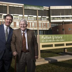 """Utah Valley University President Matthew S. Holland and Ira A. Fulton pose in front of the UVU library, which was renamed as the Ira A. and Mary Lou Fulton Library as part of the unveiling of the """"Roots of Knowledge"""" on the UVU campus in Orem on Friday, Nov. 18, 2016."""