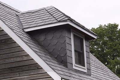 A grey hipped dormer on a hipped roof.