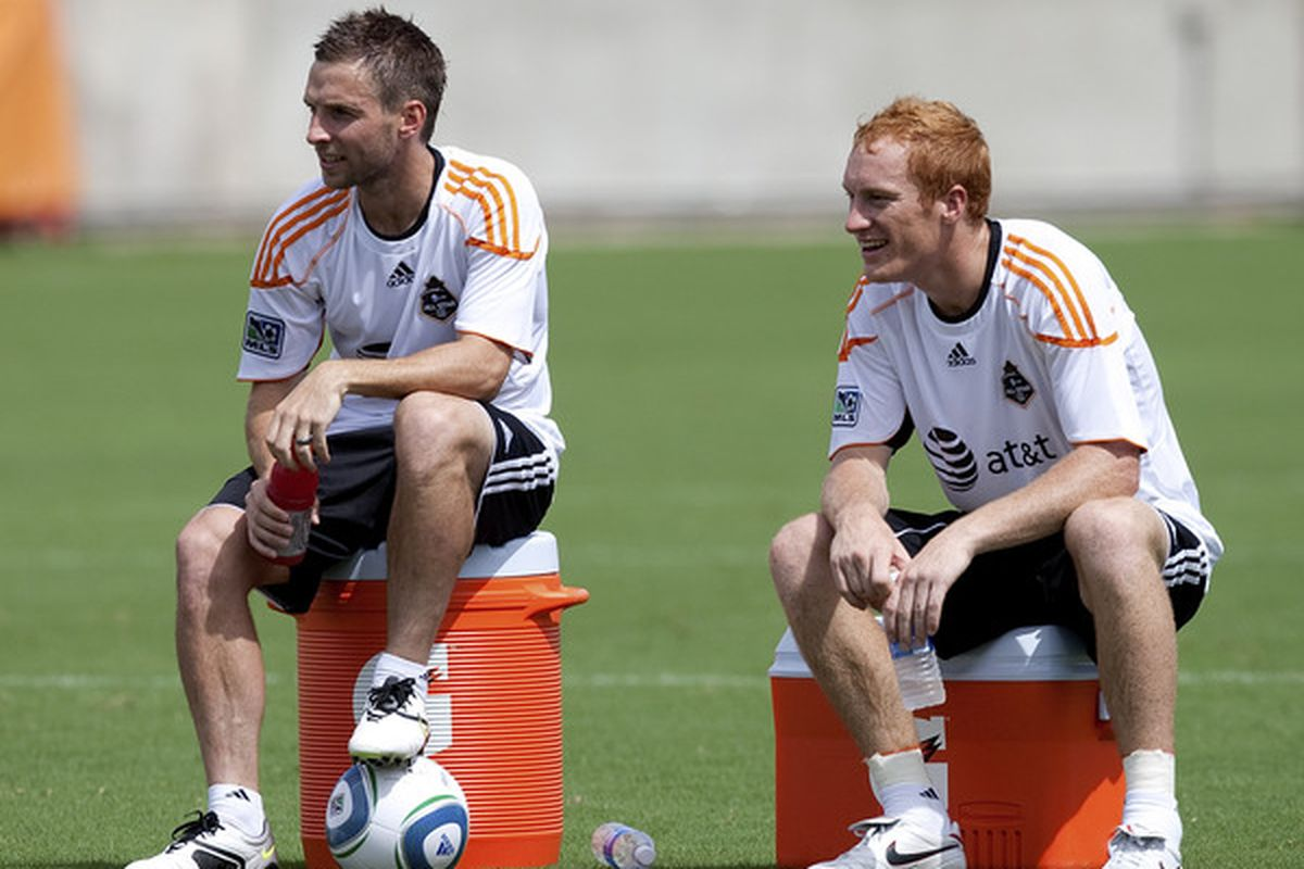 HOUSTON - JULY 27:  Jeff Larentowicz (R) takes a break during practice with the MLS All-Star team at Robertson Stadium on July 27 2010 in Houston Texas.  (Photo by Bob Levey/Getty Images)