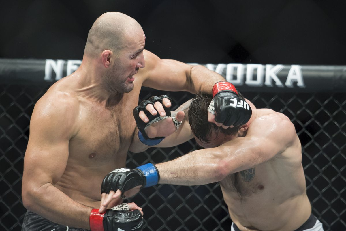 In this Sept. 14, 2019, file photo, Glover Teixeira, left, fights Nikita Krylov during their light heavyweight match at UFC Fight Night in Vancouver, British Columbia.